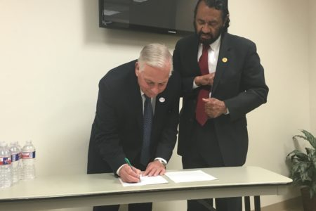 Reps. Gene Green (l.) and Al Green signing letters to the Centers for Disease Control and Prevention regarding request for Zika funding.