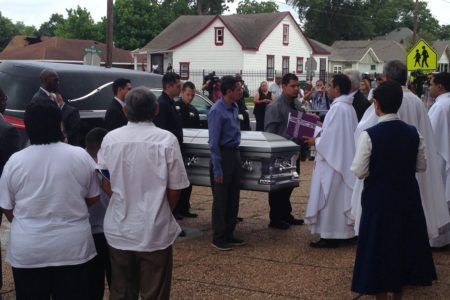 The pallbearers were greeted by a priest before entering the Holy Name Catholic Church, located north of downtown Houston.