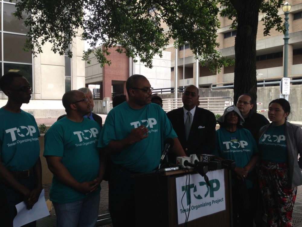Texas Organizing Project member Feldon Bonner (center) speaks at a press conference held in front of the Harris County Criminal Court building. The activist organization advocates for changes in the county's bail system.