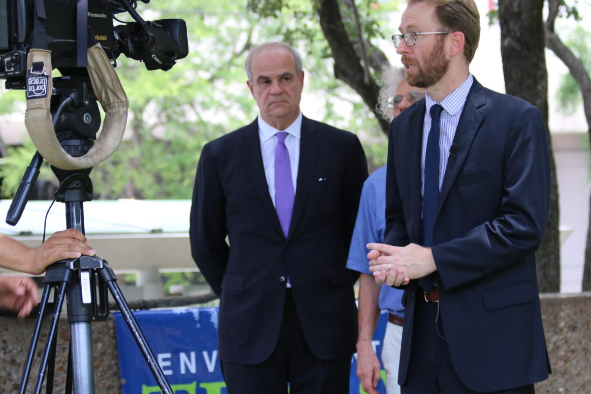 Luke Metzger with Environment Texas talks to reporters. To his right are attorney Phil Hilder and Sierra Club's Neil Carman