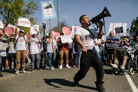 Tomas Martinez shouts through a megaphone