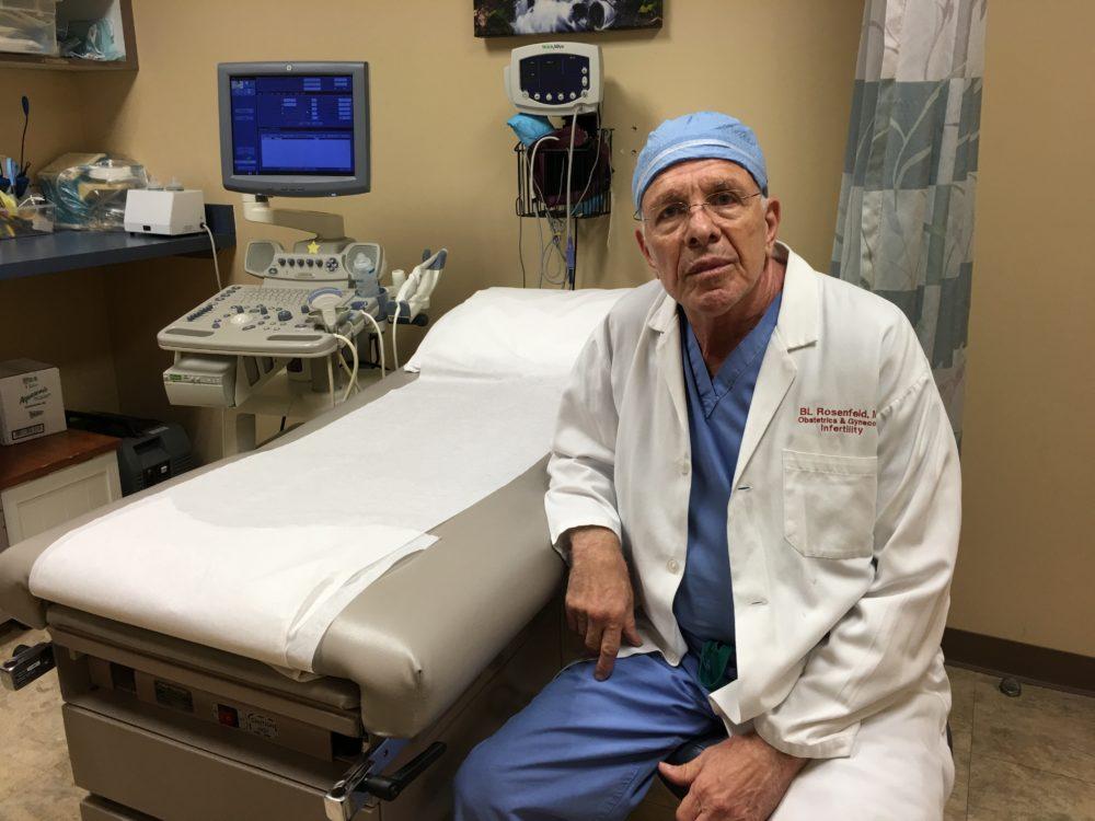 Rosenfeld leans up against patient table