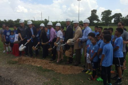 Officials with the city of Houston, Harris County Houston Sports Authority, NCAA and others break ground on the new soccer field at Milby Park.