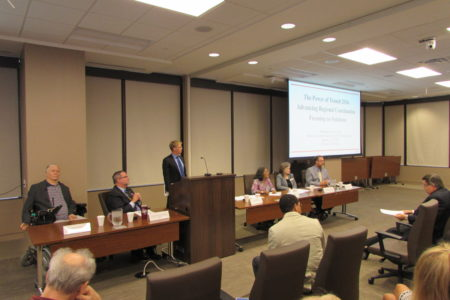 Transportation experts speak at an H-GAC forum on the challenges of providing public transit.