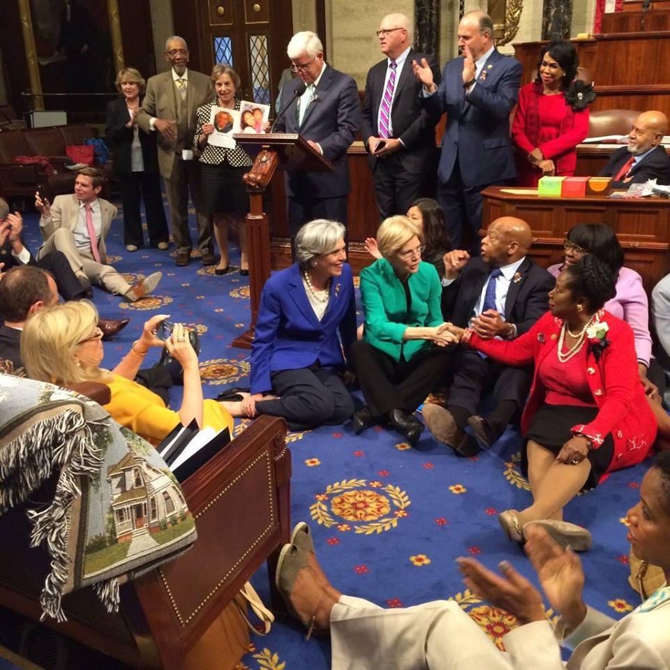 Houston Democrats siting on the floor