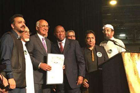 Houston Mayor Sylvester Turner, ISGH President M.J. Kahn and others celebrate at NRG Center.