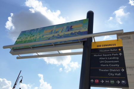 The overhead signs also feature works by local artists.