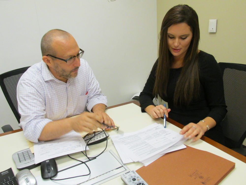 Jeff Gold, staff attorney at the Houston College of Law, goes over a taxpayer case with law student Hannah Craft.
