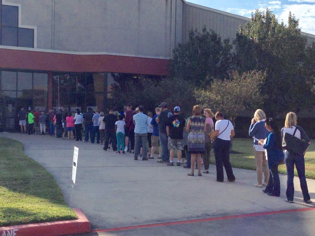Voters lined up since 8:00 a.m. at the Champion Life Centre, in Spring, on Monday October 24th, the first day of Early Voting.