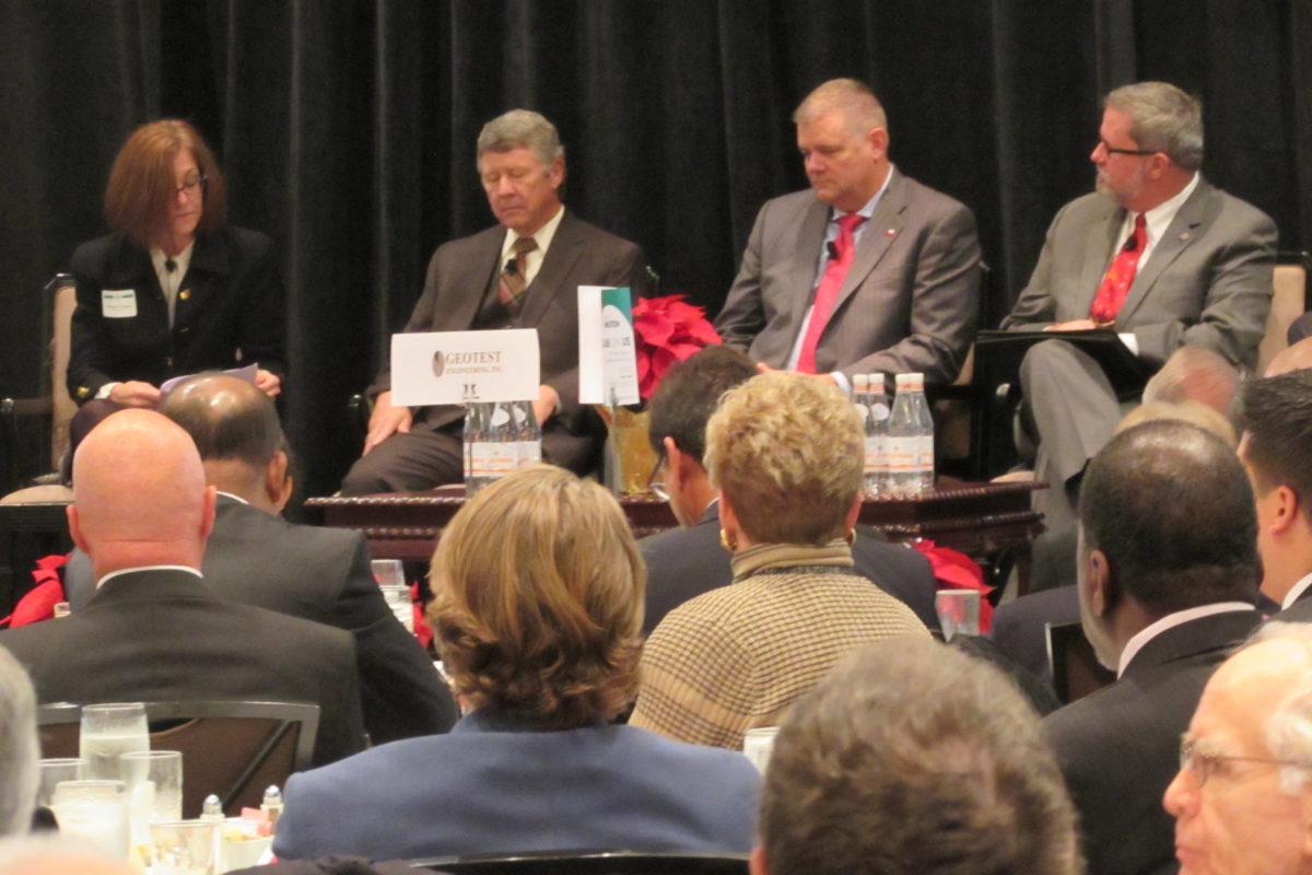 Moderator Maureen Crocker of the Gulf Coast Rail District (left) talks with Harris County Judge Ed Emmett, Galveston County Judge Mark Henry, and Brazoria County Judge Matt Sebesta.