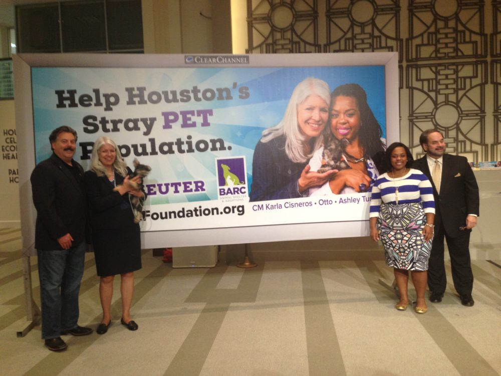 Alan Ratliff, chair and president of Houston BARC Foundation, Council Member Karla Cisneros –who is holding Otto— Ashley Turner, Mayor Sylvester Turner's daughter and Lee Vela, vice president of Public Affairs of Clear Channel Outdoor pose next to the campaign's billboard.