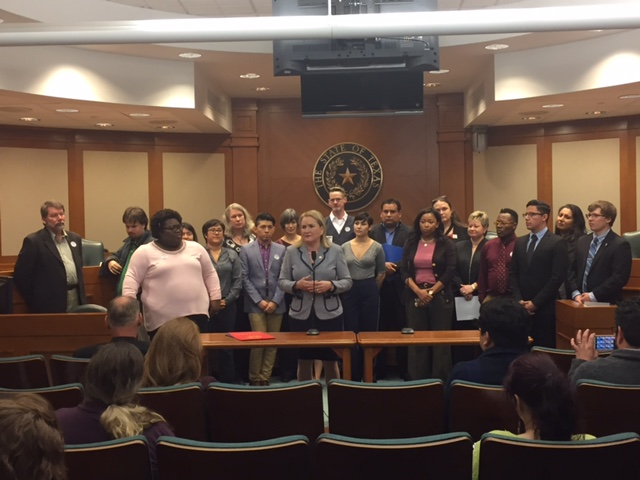 Fran Watson, president of the Houston GLBT Political Caucus, looks at State Senator Sylvia Garcia during a press conference held in Austin as members of the group visited the Texas Capitol to voice their concerns over SB4 and SB6.